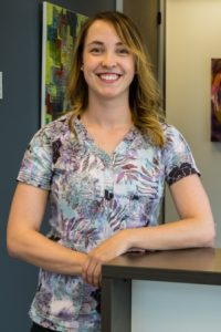 Whittney Millsap, Registered Dental Technician, in the reception area at Kelowna Denture Clinic